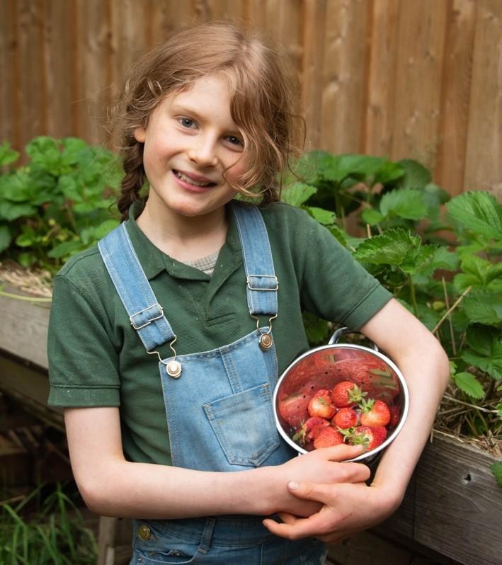 Thomas, a Cub Scout farming organic food at home