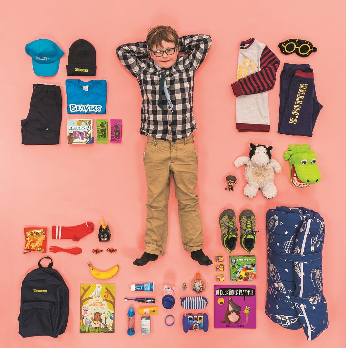 Dylan, a Beaver Scout, with all of his favourite things he takes on camp