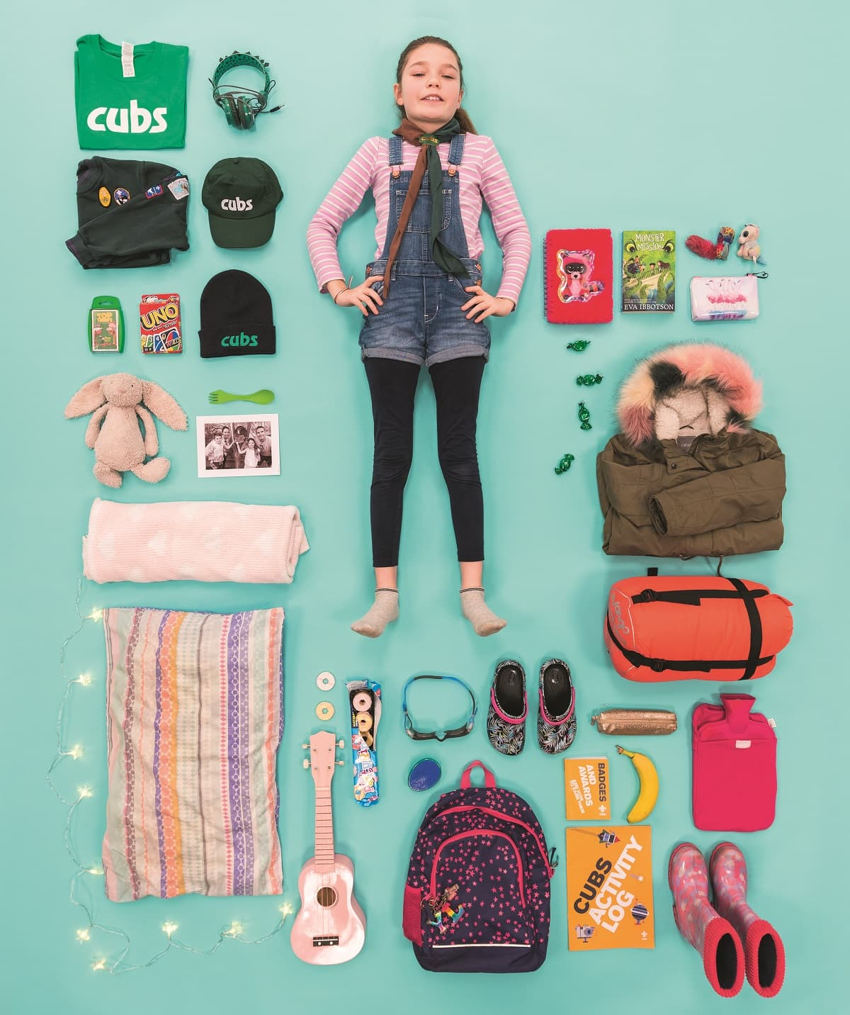 Lily, a cub scout, with all of her favourite things she takes on camp